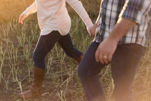 couple walking through a field- postpartum depression
