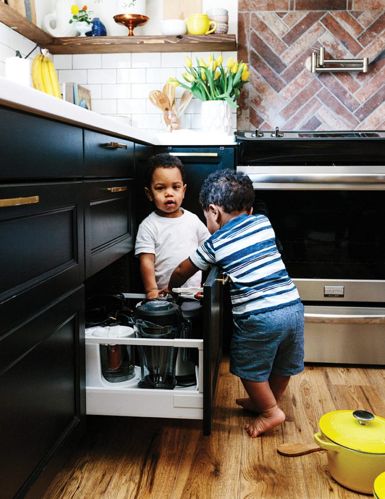 Twin boys playing in Leons Kitchen